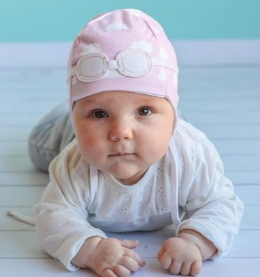 newborn wearing pink cloud hat