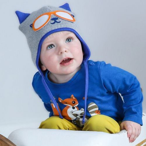 boy wearing blue and grey baby cat hat