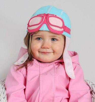 girl wearing blue and pink pilot hat