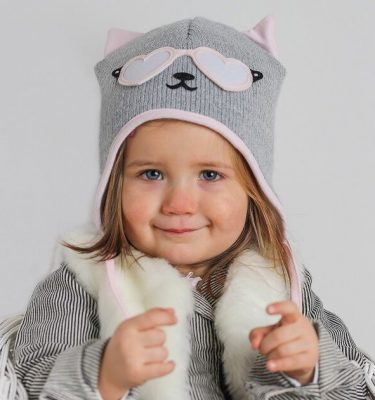 girl wearing grey and pink baby cat hat