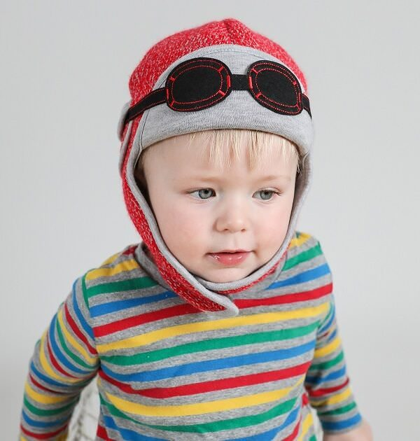 baby boy wearing knitted red hat