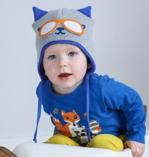 baby boy wearing grey and blue knitted baby hat