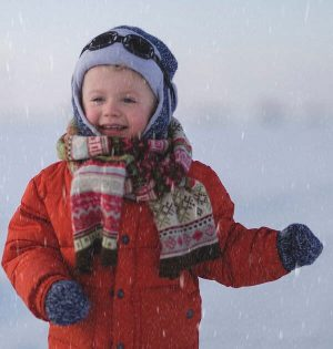 baby boy wearing knitted winter gift set