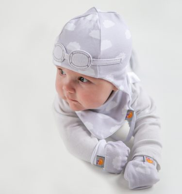 newborn wearing a grey cloud pattern gift set