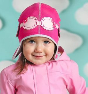girl wearing pink pilot baby hat