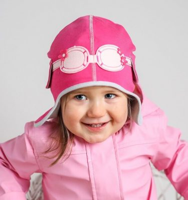 girl wearing pink pilot hat