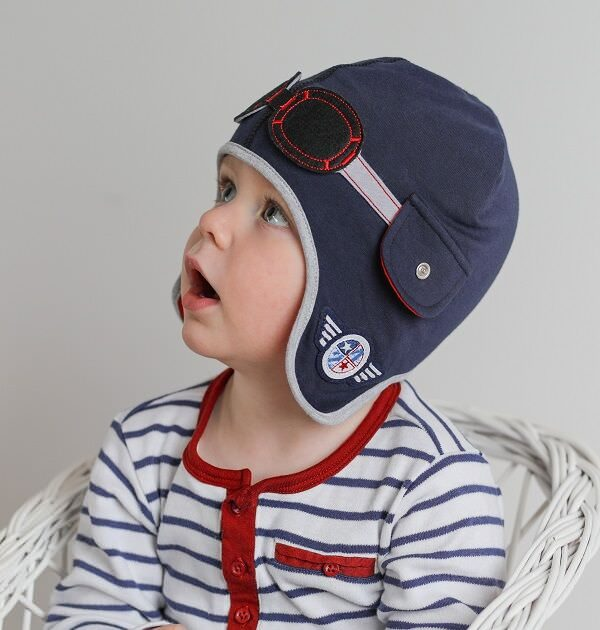 boy wearing blue pilot baby hat
