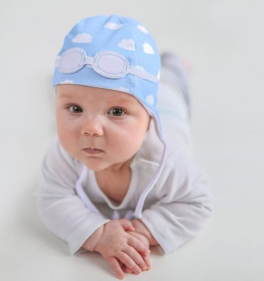 newborn wearing blue cloud hat