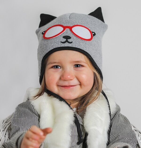 girl wearing grey and black baby cat hat