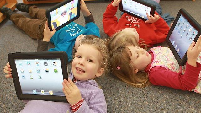 children playing with ipads