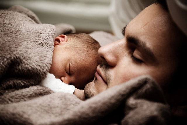 sleeping baby with dad